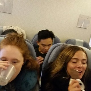 Becca and Jade eating on plane.jpg